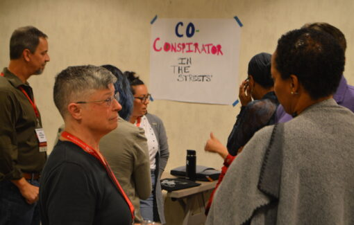 CFA members breakout into groups during an Equity Conference session.