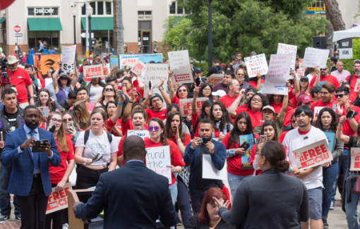 CFA members dress in Red for Ed tshirts and hold signs as they rally at the Sacramento Capitol for improved funding for the CSU.
