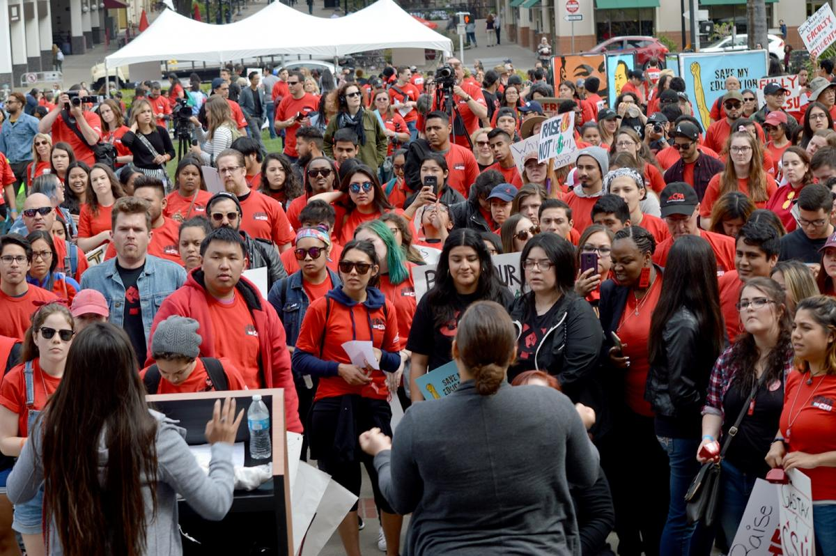 CFA members and students wear red shirts at a Sacramento rally advocating for more CSU funding.