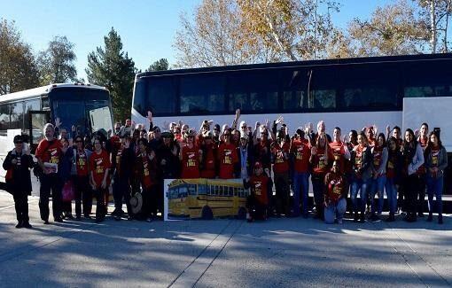 CFA San Bernardino members ready to board a bus to rally for higher education.