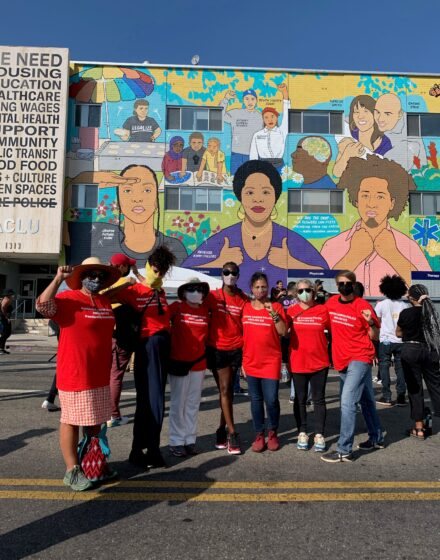 CFA-Los Angeles members at the ACLU building downtown gather in front of colorful mural.