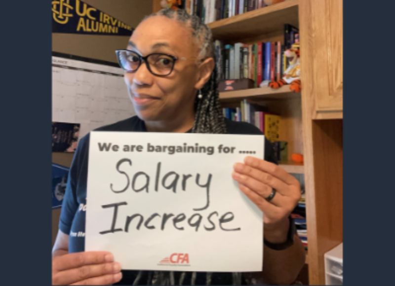 """CFA member Monisha Miller holds a sign saying """"We are Bargaining for Salary Increase."""""""